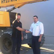 large_want_access_branch_manager_chris_ryan_taking_delivery_of_600th_machine_from_paul_sultana_haulotte_area_manager_nswact_2_0.jpg